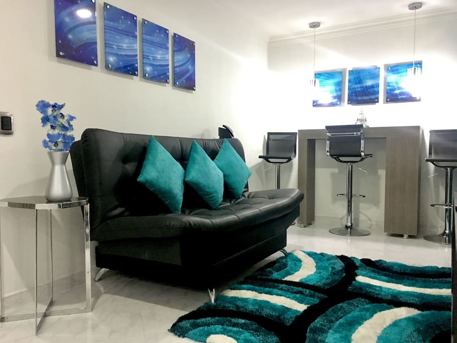 Living Room with Smart TV, Sofa Bed, Bar, Phone, Cable, Wifi, Fan and Balcony