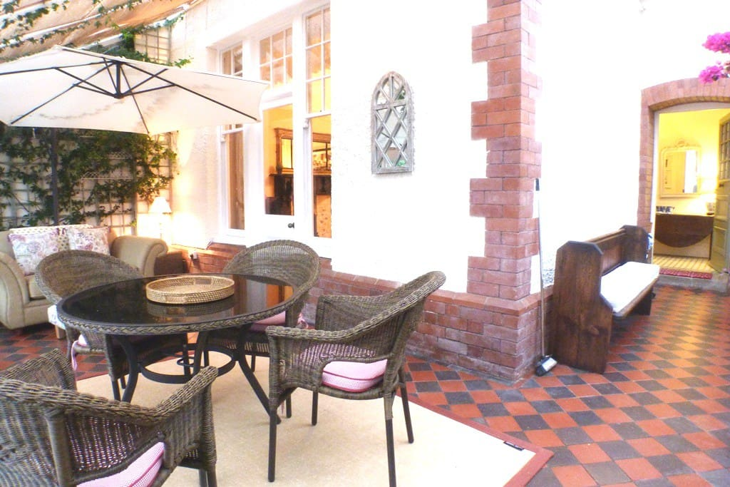 Beautiful sun room leading onto pretty garden with private terrace.