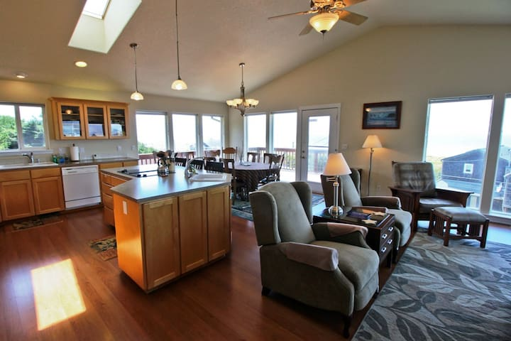 Large kitchen and dining area with spectacular ocean and mountain views.