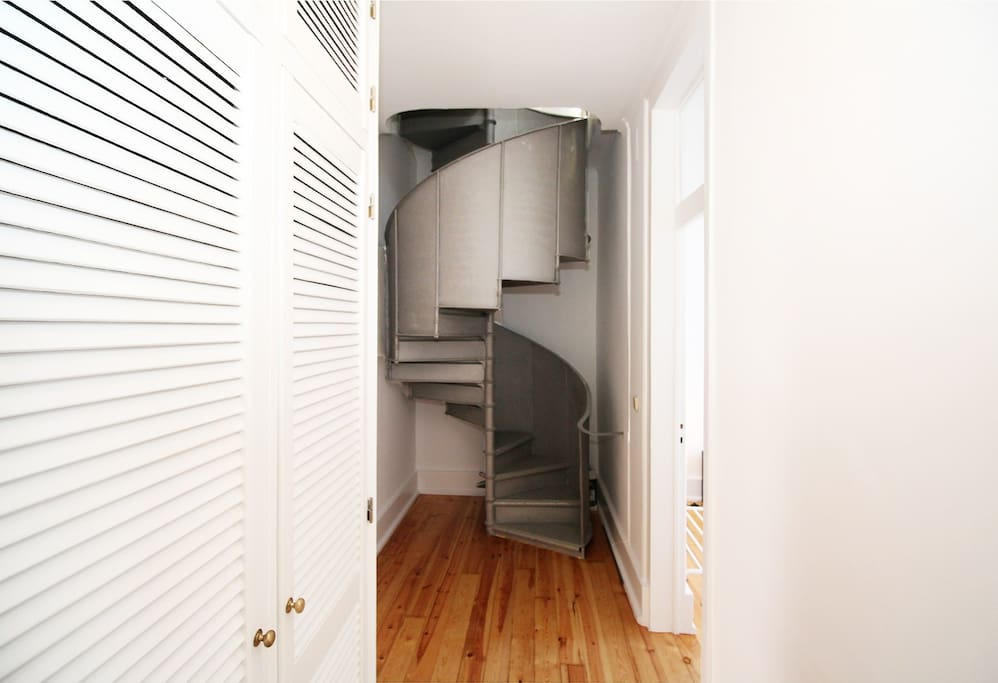Corridor and spiral stairs to Duplex
