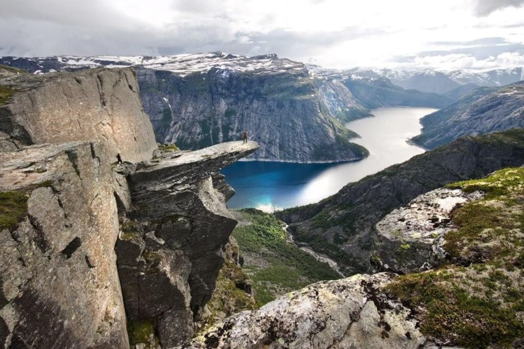 """Trolltunga - This spectacular, world-famous rock formation is known as """"the worlds best selfie-spot"""" is only ca 3 quarters time to drive, depending om traffic on the narrow road from Tyssedal up to Skjeggedal, where hiking start. P-fee depends on time. You can take a local taxi from here, or a shuttle bus from Odda/Tyssedal to and Skjeggedal.  This causes less traffic on that narrow mountain road. A though hike - be prepared!"""