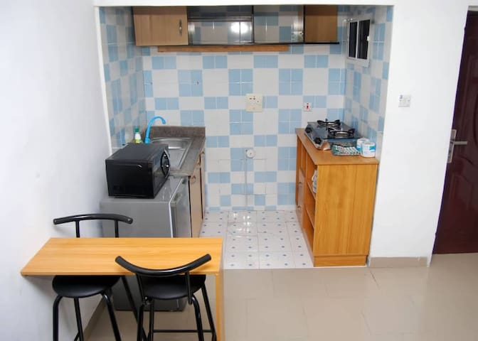 Kitchen with high table,microwave,fridge,gas cooker!Make your meal
