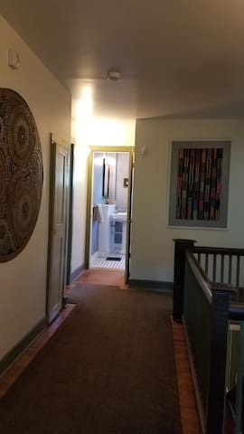 Upstairs hallway gives you access to your room and your shared bathroom.