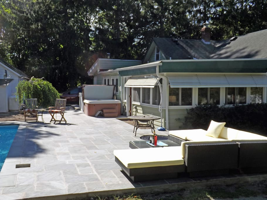 Rear patio, pool, and jacuzzi over brand new flagstone masonry.