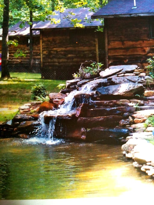 View of all four cabins from the pond waterfall.