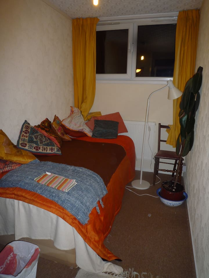 Single bed room with built in cupboard for storage. Light, small table. Windows opening  morning sun.