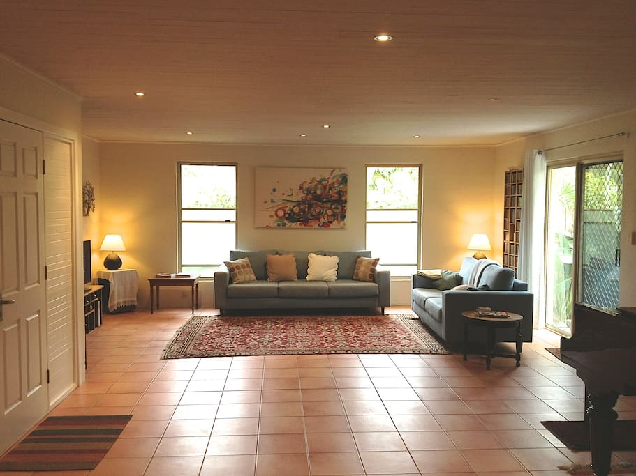 Large living area with french doors and adjoining courtyard