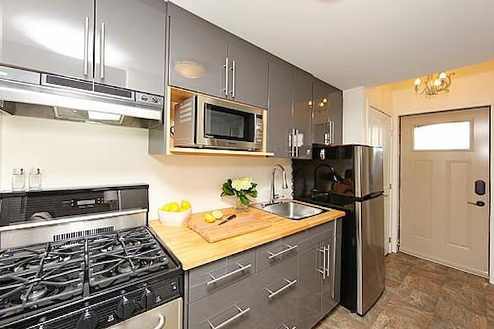 Modern kitchen, fully stocked with gas stove.