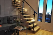 Stairs to the loft with dimmable LED-spots.