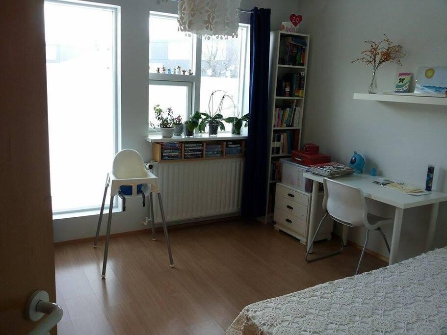 Larger bedroom.