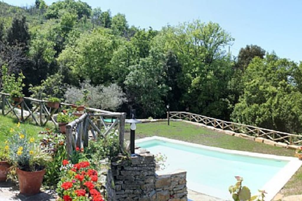 Villa Trotta is located on the slope of a hill covered in olive groves and Mediterranean vegetation.