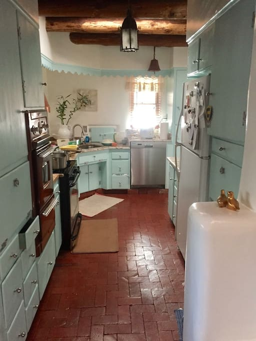 Cheery galley kitchen with gas stove, water filtration, and all the necessities of home.