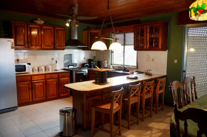 Fully loaded kitchen. Elictrical appliances, fridge, stove, pots, pans, dishes etc.