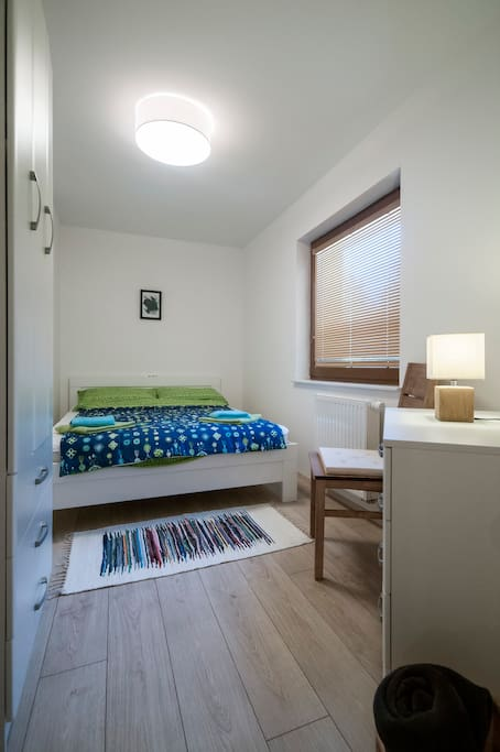 The separated bedroom has a comfortable double bed