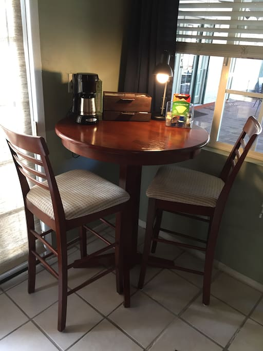 Breakfast Bistro Table with Lamp, Coffee Maker a Selection of Teas and Condiments