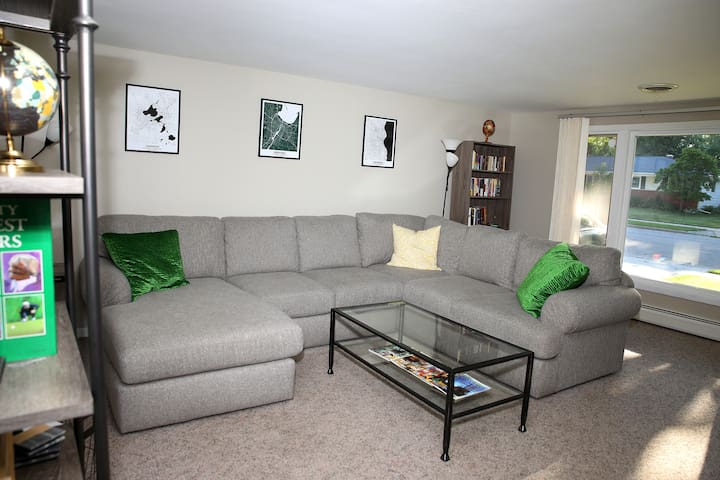 Spacious living room with huge, comfy couch. The perfect place to relax before (or after) game day!