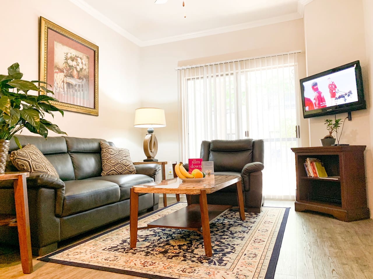 Living Room-Very spacious & includes TV with Netflix, AmazonTV, live TV via Sling TV App. New full-size comfy leather couch, sofa chair, & high speed 50mbps Wifi. Personal outdoor patio access with outdoor table and seating