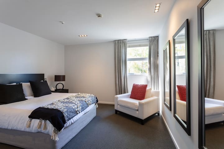 Some beds can be split into king singles for the kids.  This bedroom is designed with you in mind, with wall plugs next to the bed (where they should be!) for convenient device charging.