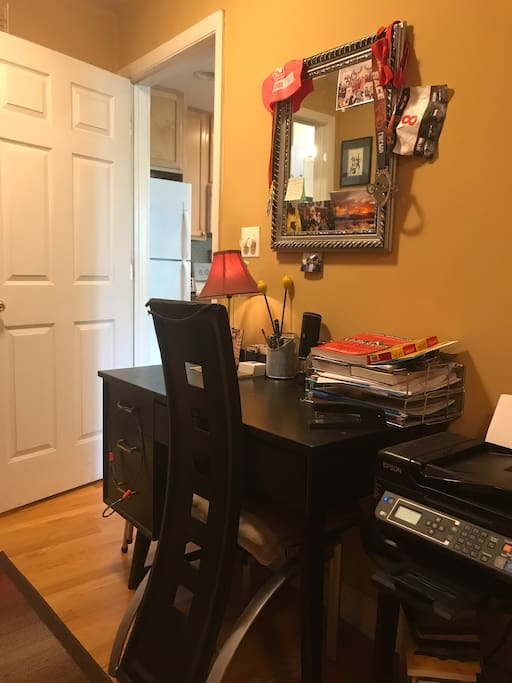 Desk with access to printer in the bedroom