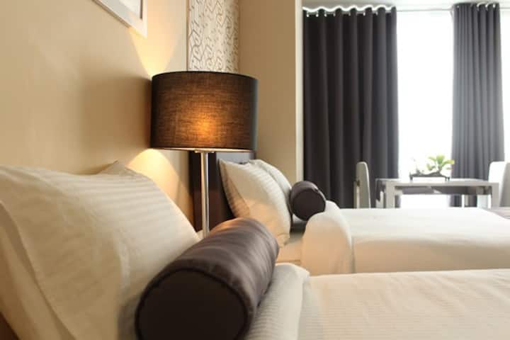 Twin Suite by C Suites at Two Central Residences