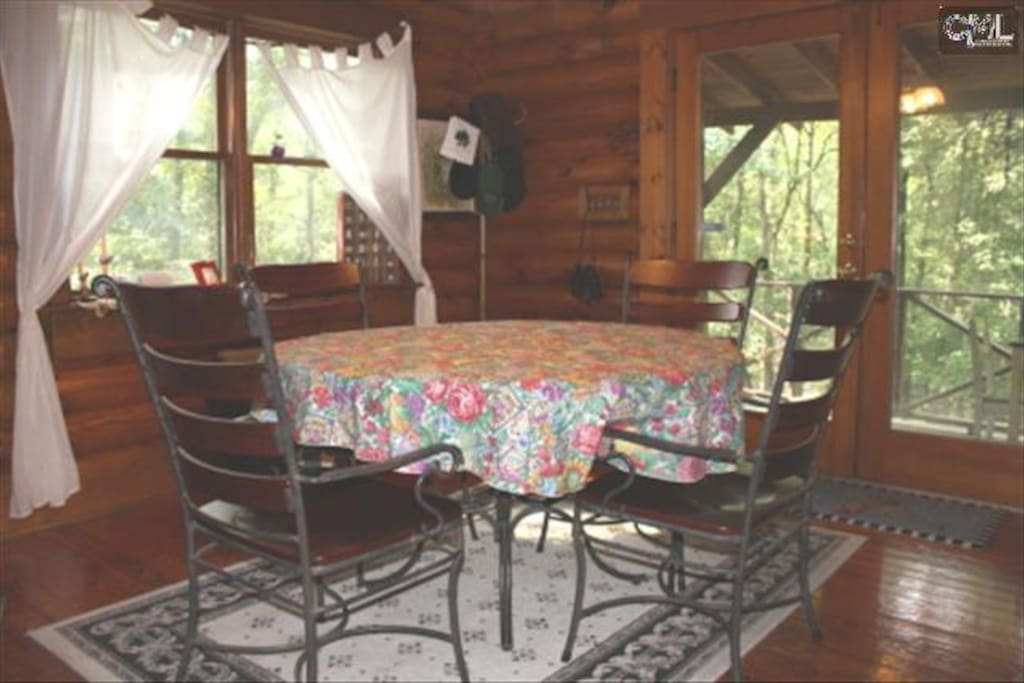 Dining area with lots of windows for viewing the beautiful scenery.
