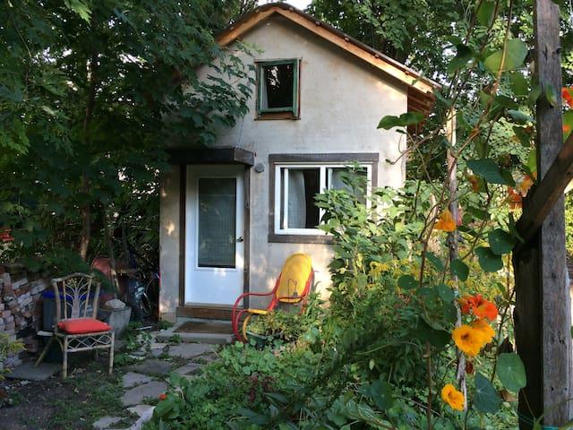 Private cabin in backyard garden
