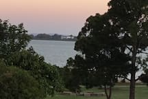 View from our place across the park to Moreton Bay at dusk