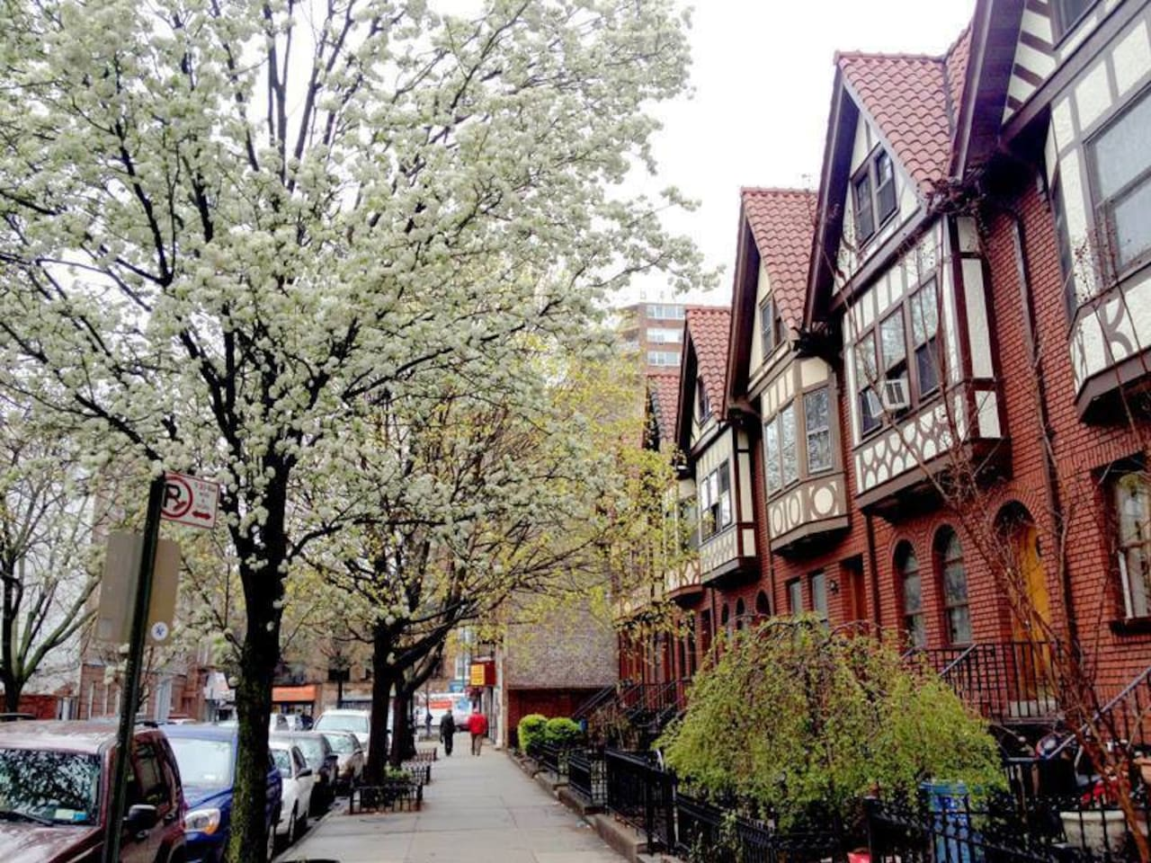 These iconic Tudor row houses were built in 1915, on what was formerly the horse stables for the surrounding brownstone houses  built two decades earlier, after the automobile rendered horses obsolete.