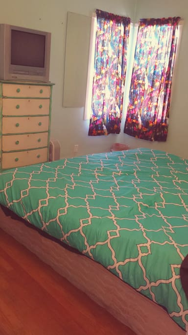 Cute bedroom with great light and dark curtains. King Size Bed. TV with dvd/vcr player and basic cable.