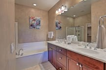 Sink into the soaking tub of the master bath.
