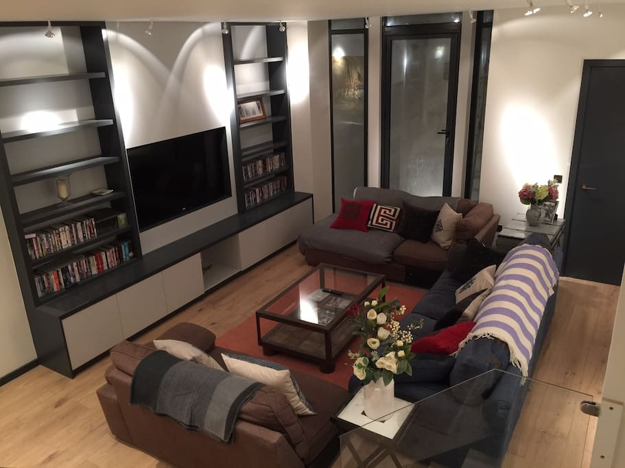 "Comfortable sitting room with 65"" TV and state of the art media entertainment."