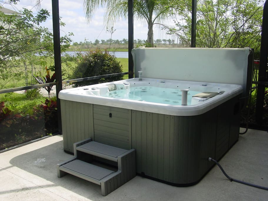Hot tub in screened in area.
