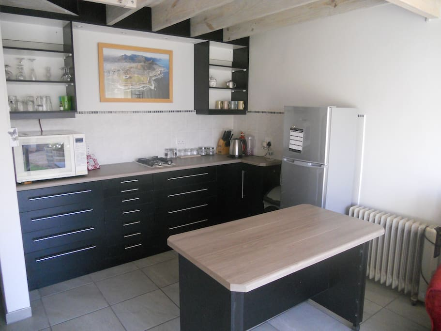 Compact kitchenette with move-able table