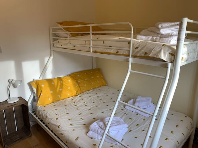 Second bedroom with double and single bed