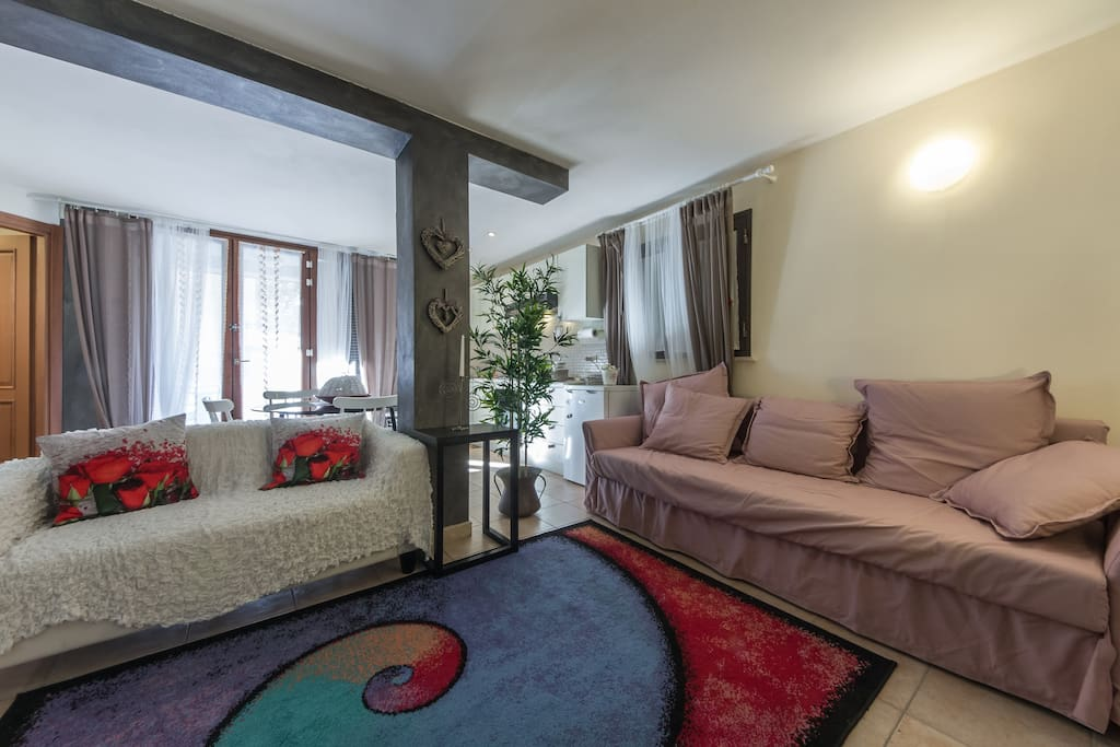 The Living Room with two Sofas. One of them is a comfortable Sofa Bed ideal for two adults!