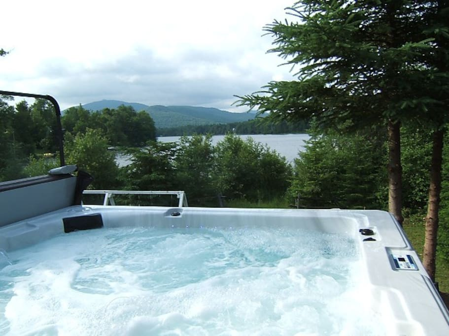 hot tub / spa with view of Mont-Tremblant