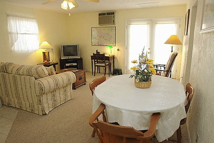 The combined living room kitchen has all the comforts of home.  The couch pulls out to full size bed.