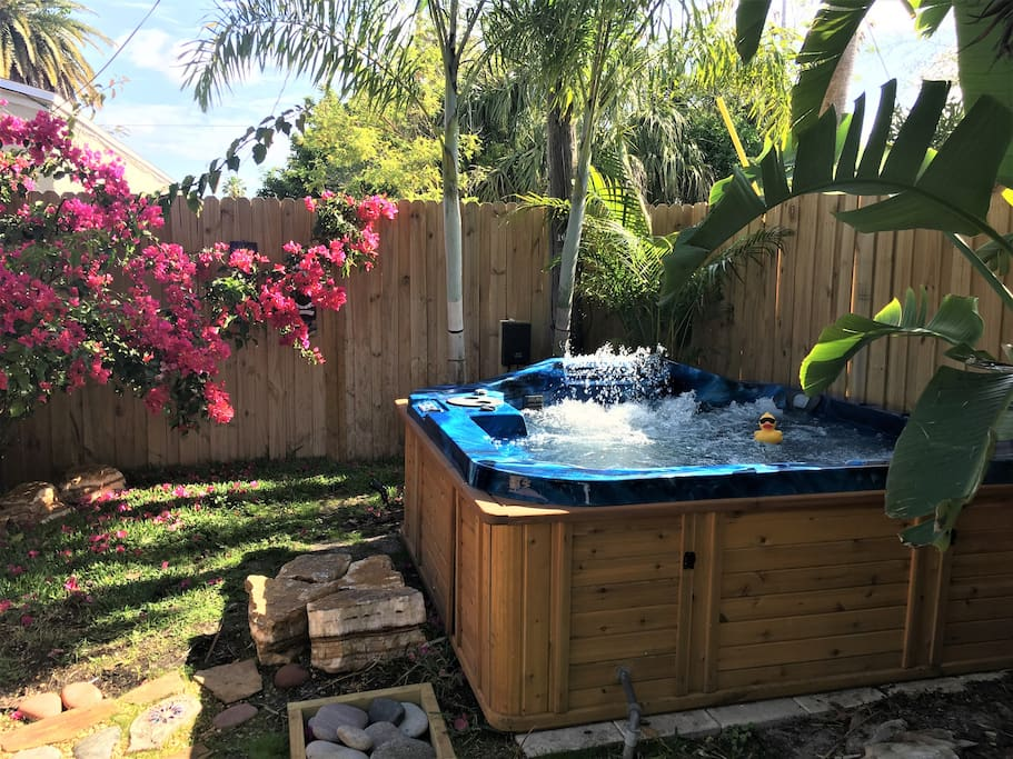 Private hot tub in privacy fenced yard. Lots of jets, a waterfall feature and beautiful color changing lights make this great place to relax! This yard cannot be entered, shared or seen by anyone in the main home.