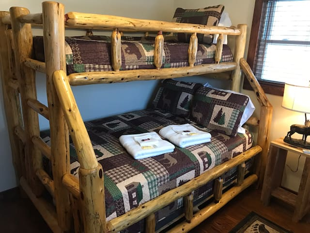 Have fun sleeping in the solid wood bunk bed in bedroom in middle unit.