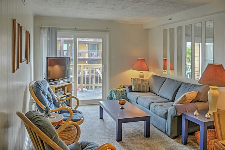 Watch movies in the spacious living room.