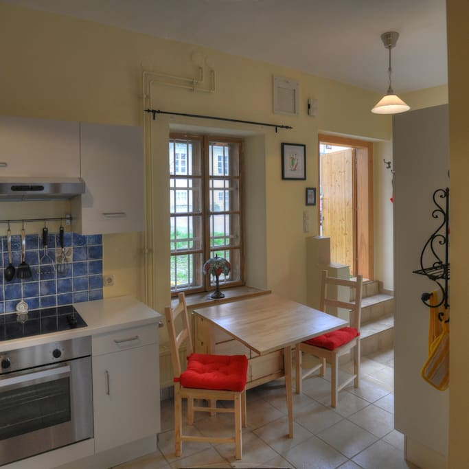 Kitchen was Newly Remodeled in 2012 with Stove, Oven, Dishwasher, Refrigerator; Table Expands to Seat Six