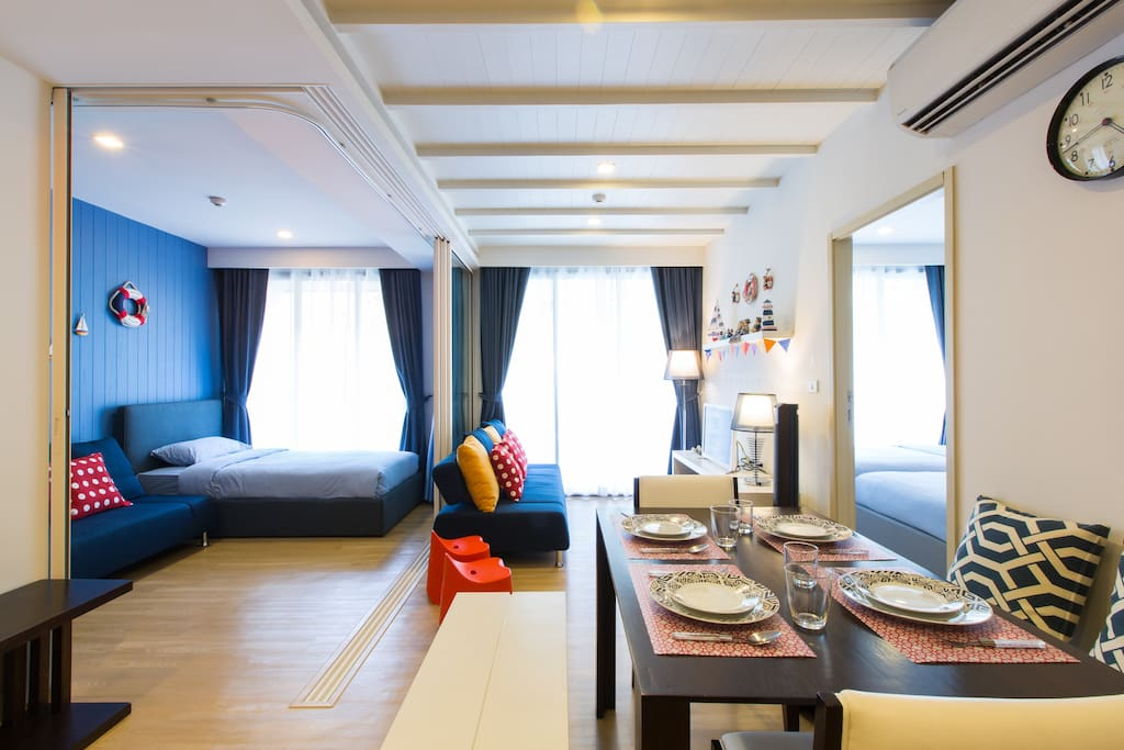 """Fully furnished in a """"fun nautical theme"""", and is equipped with 2 bedrooms, 2 bathrooms (both with hot rain showers and toilets), a kitchen, dining area, dining amenities and a large balcony overlooking the swimming pool."""