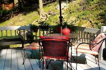 Small but cozy and colorful deck to use during warmer weather.