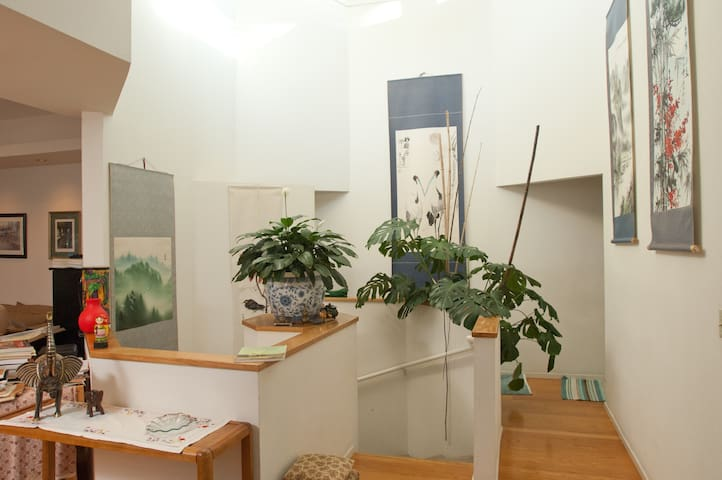 Entry Hall filled with light, Chinese scroll paintings, bamboo from our garden and indoor plants