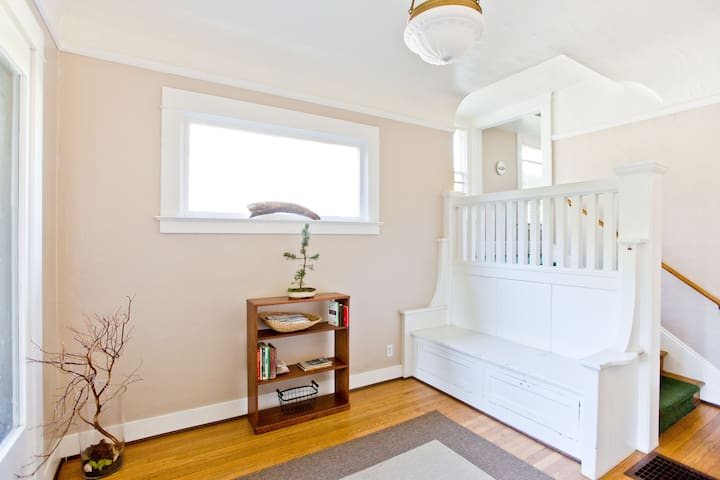 The entryway leads to all of the units in this 1910 home