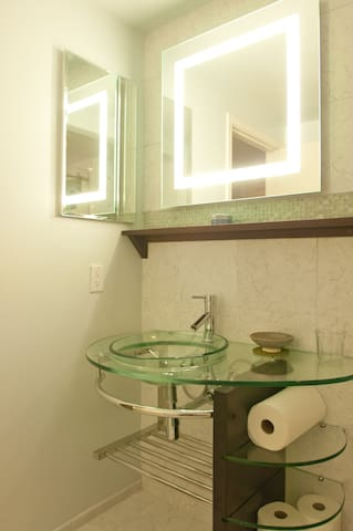 Bathroom designed for guests - your own private drawer, shared hairdryer and amenities in the medicine cabinet on the left