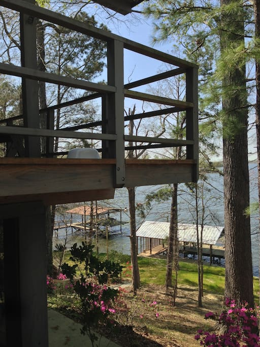 Looking from side grilling patio.  View of house and swimming pier