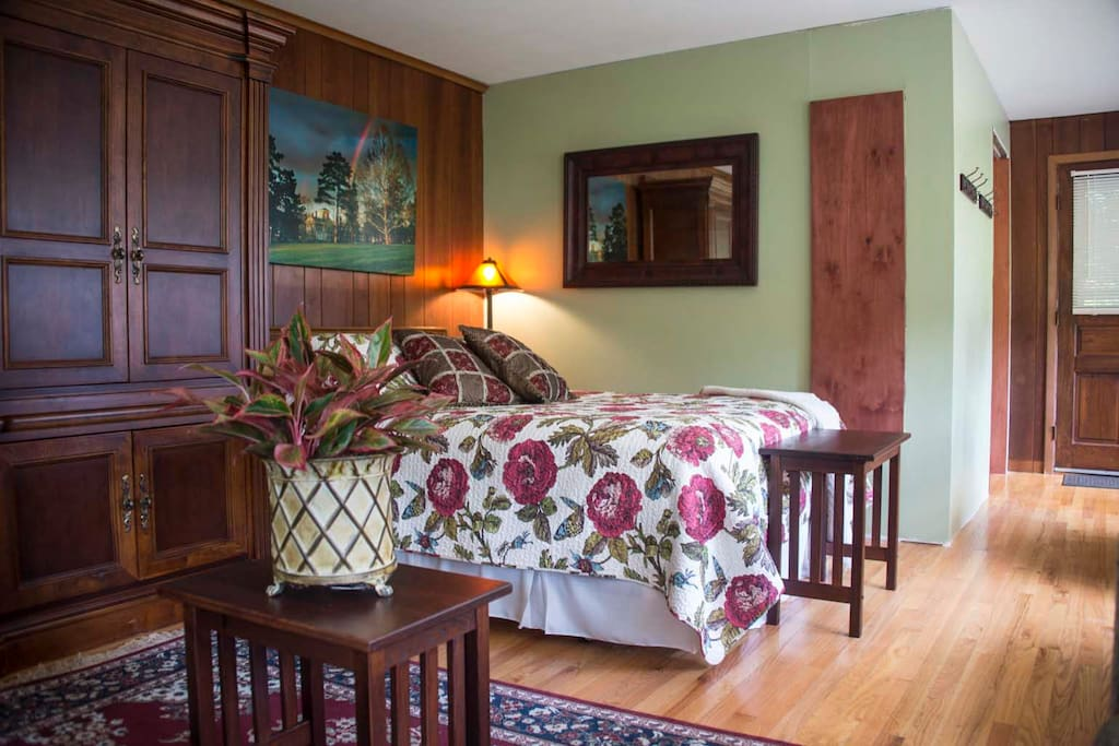 First Floor -Paneled Bedroom with queen bed, spacious bath and private entrance.