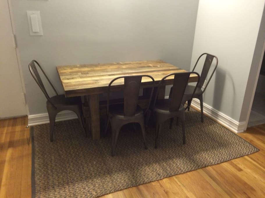 Reclaimed pine dining table with Restoration Hardware Chairs