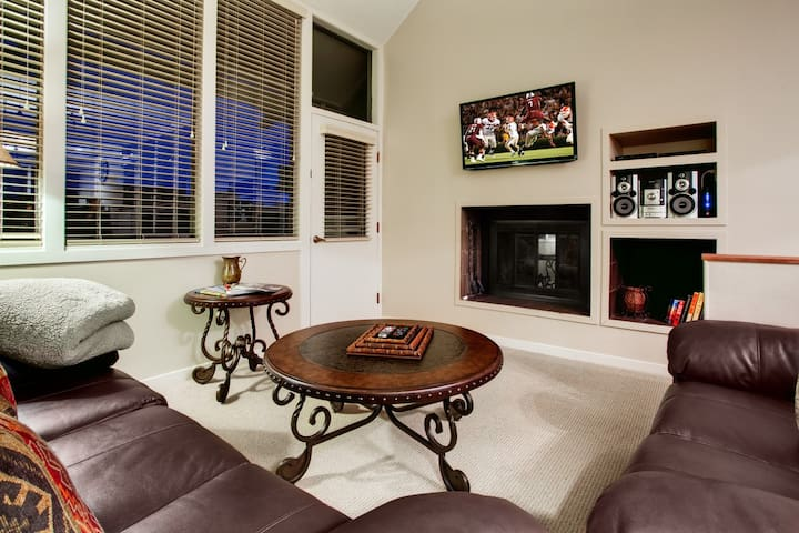 Living Room with brand new flatscreen, fireplace, and out door patio